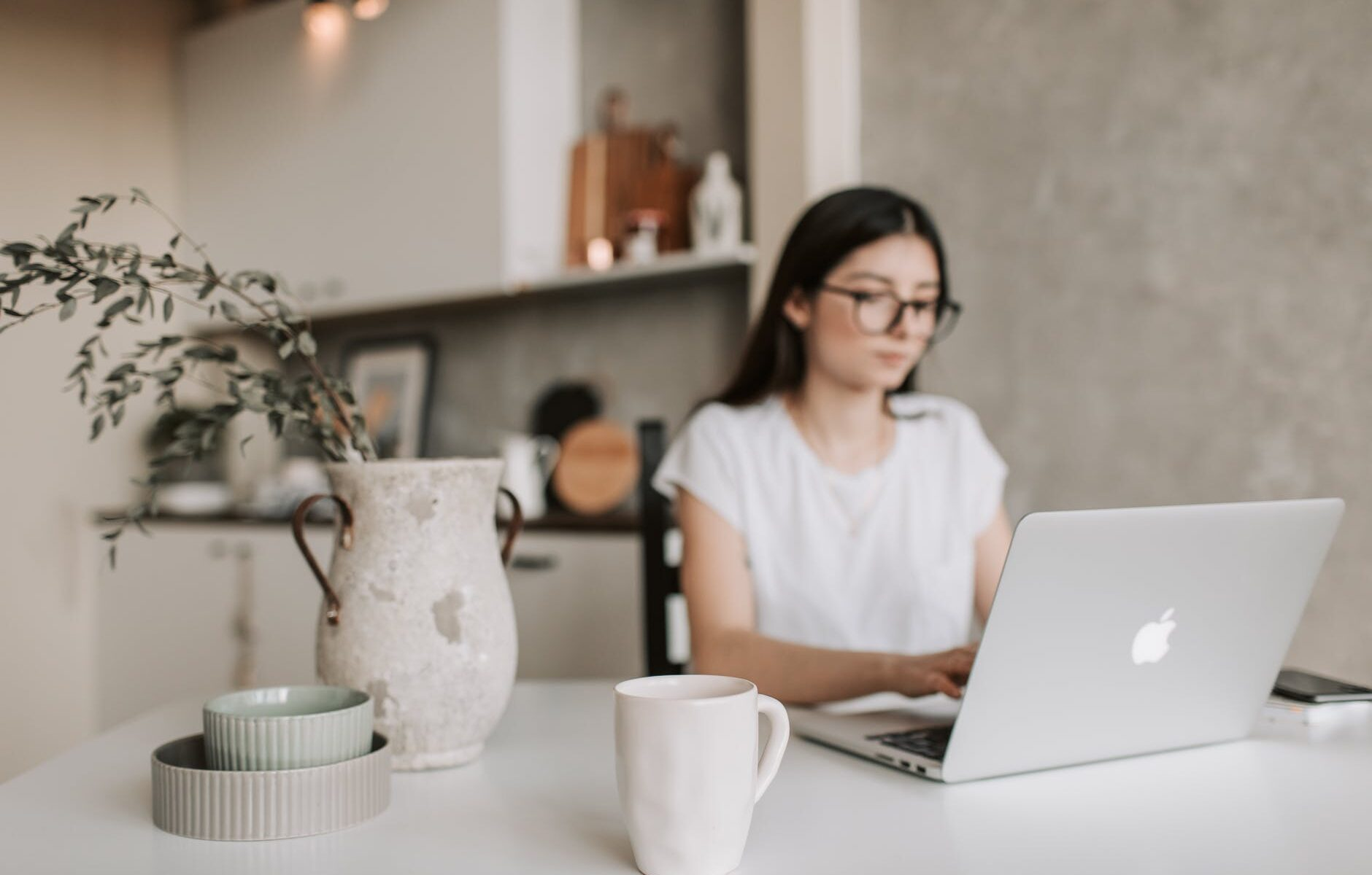 focused young businesswoman working remotely at home